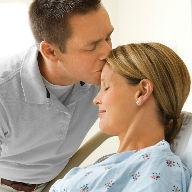Husband kisses wife in hospital image